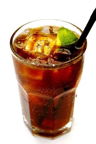 Cuba Libre: 0.5 oz lime juice, 2 oz light rum, 5 oz chilled cola, lime wedge. My favorite rum drink.