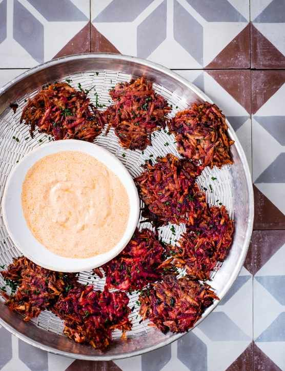 Veggie Fritters With Harissa Check out these spicy veggie fritters with punchy harissa yogurt. These fritters pack plenty of flavour and make for a great snacking recipe