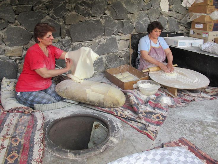 Women prepare traditional Armenian bread using an underground oven at the Garnitoun Restaurant in Garni.