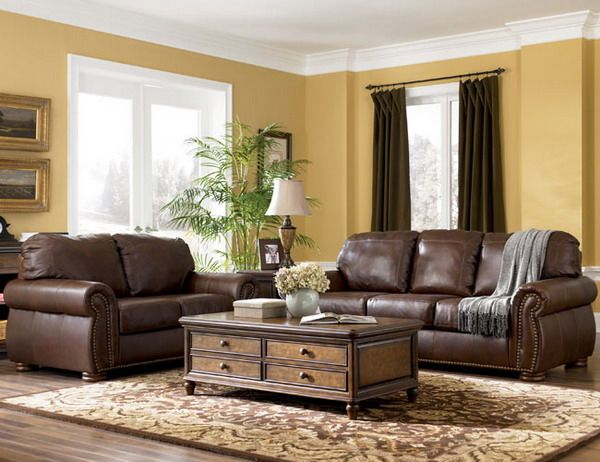 Traditional Living Room Furniture Design - I love the brown leather couches and the extra storage in the coffee table