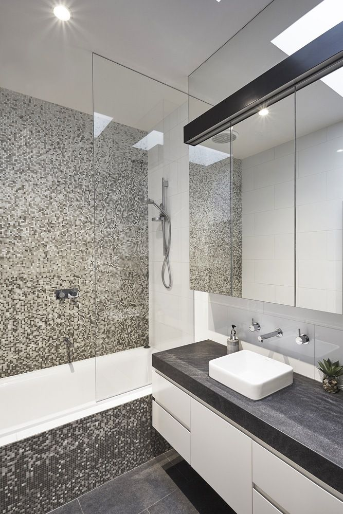 Smaller bathroom but with similar focus on the material qualities.