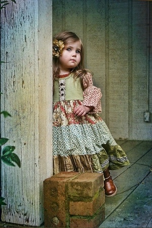 Vintage little girl.  Such beautiful colours in this evocative photograph.