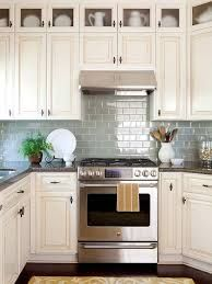 Image result for white hexagonal tile backsplash traditional cream cabinets