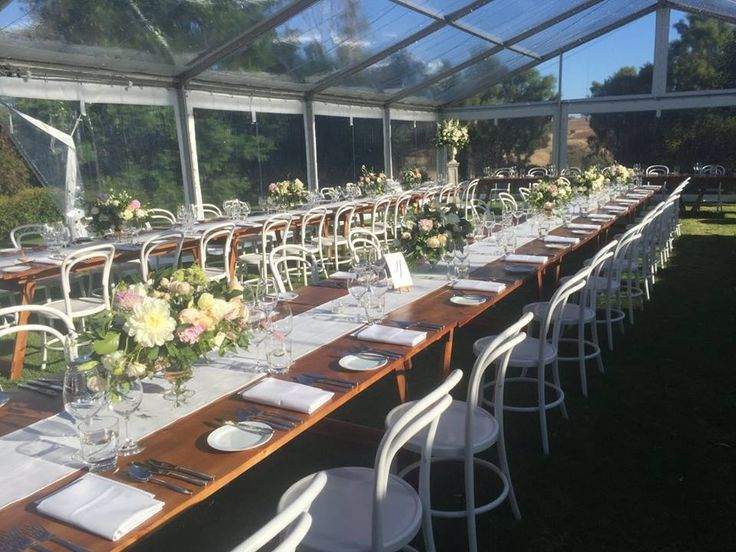 white bentwood chairs at kingsford homestead with beautiful blooming bridal flowers