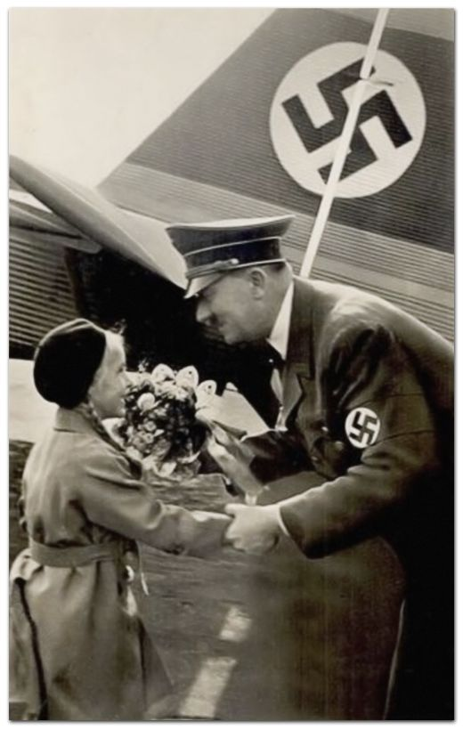 """A complete master of lies and deceipt, here we see a """"friendly leader with a young admirer. Reality could hardly be more different.  Hitler being greeted by a young German girl, 1942"""