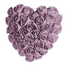 Update your look with this super stylish heart shaped cushion with gorgeously elegant rose detailing. 100% polyester. Spot clean only.