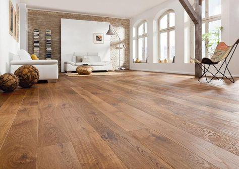 Parquet en bois massif dans le salon de style rustique moderne. http://www.m-habitat.fr/sols-et-plafonds/parquets/pose-d-un-parquet-en-bois-massif-527_A
