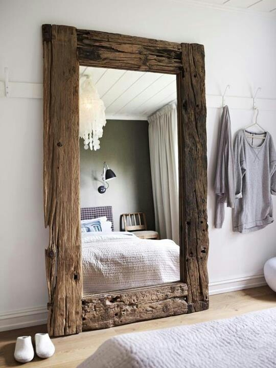 Love this rough hewn wood mirror InteriorsDetails in