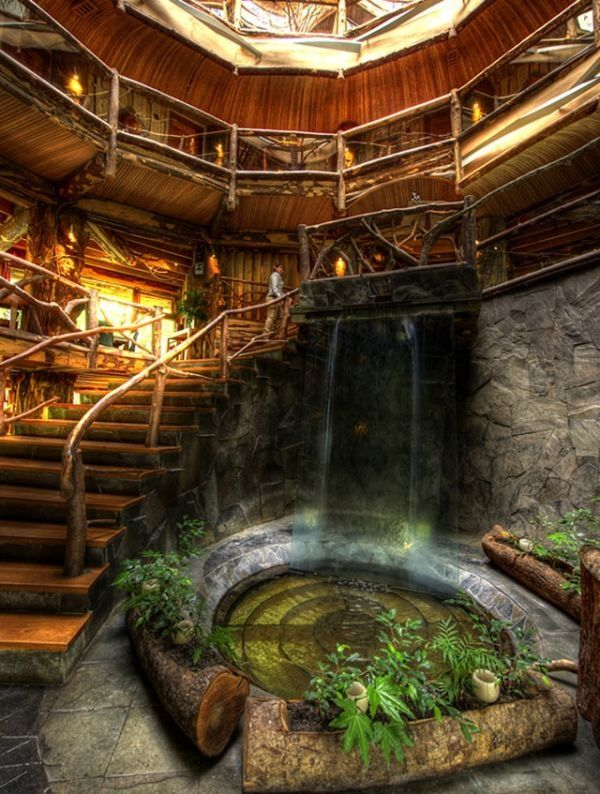 Fairytale hobbit cottage - Tree logs & waterfall garden - Magic Mountain  Hotel in Chile - Interior Design & Decor - Magical Places & Spaces -
