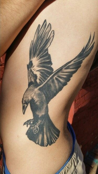 Healed raven tattoo on ribs using pride aftercare lotion for Aftercare of tattoos