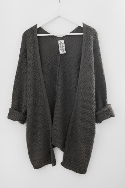 Slouchy sweater knit cardigan Long dolman sleeves Loose fitting Asymmetrical silhouette 55% Acrylic 45% Cotton Imported