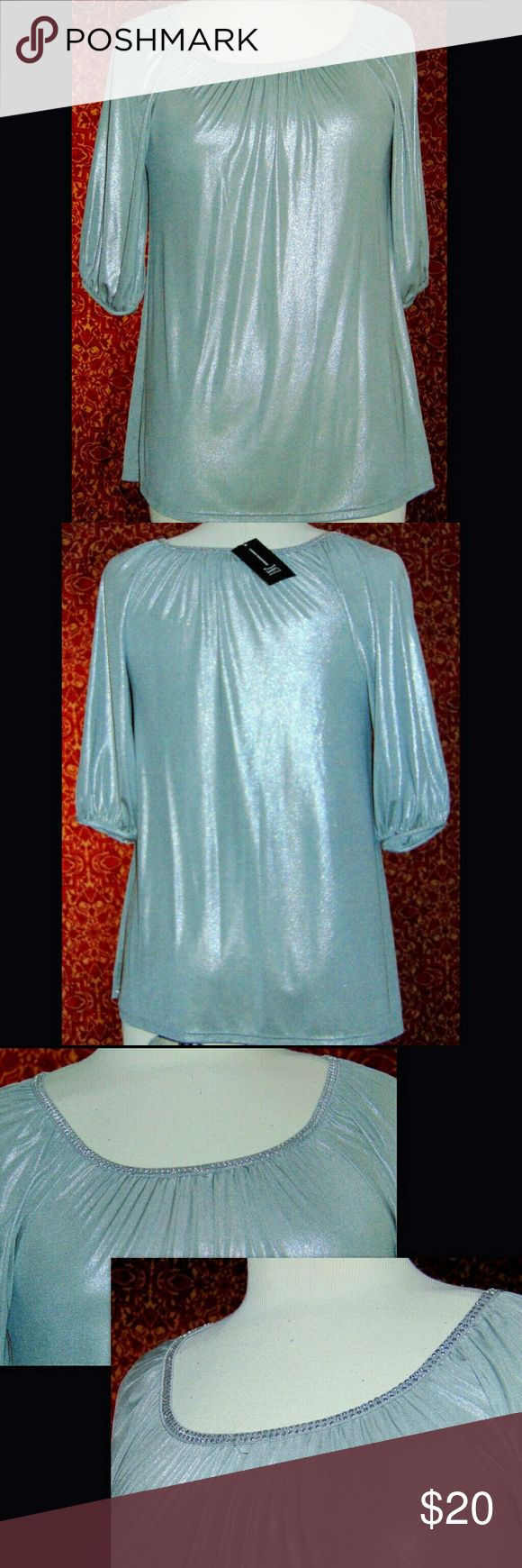 NWT INC INTERNATIONAL CONCEPTS silver blouse NWT: Slinky, stretch knit polyester with spandex blouse.  It has a metallic silver look.  Neckline has faux rhinestones.  sleeves has banded cuffs. INC International Concepts Tops Blouses