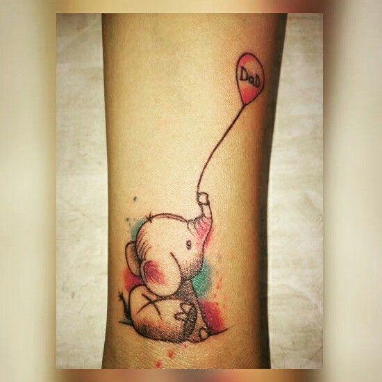 Baby elephant holding balloon