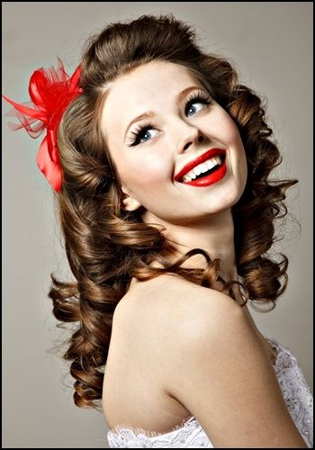 Colored feathers for bride instead of traditional veil. Great makeup for pinup bride!