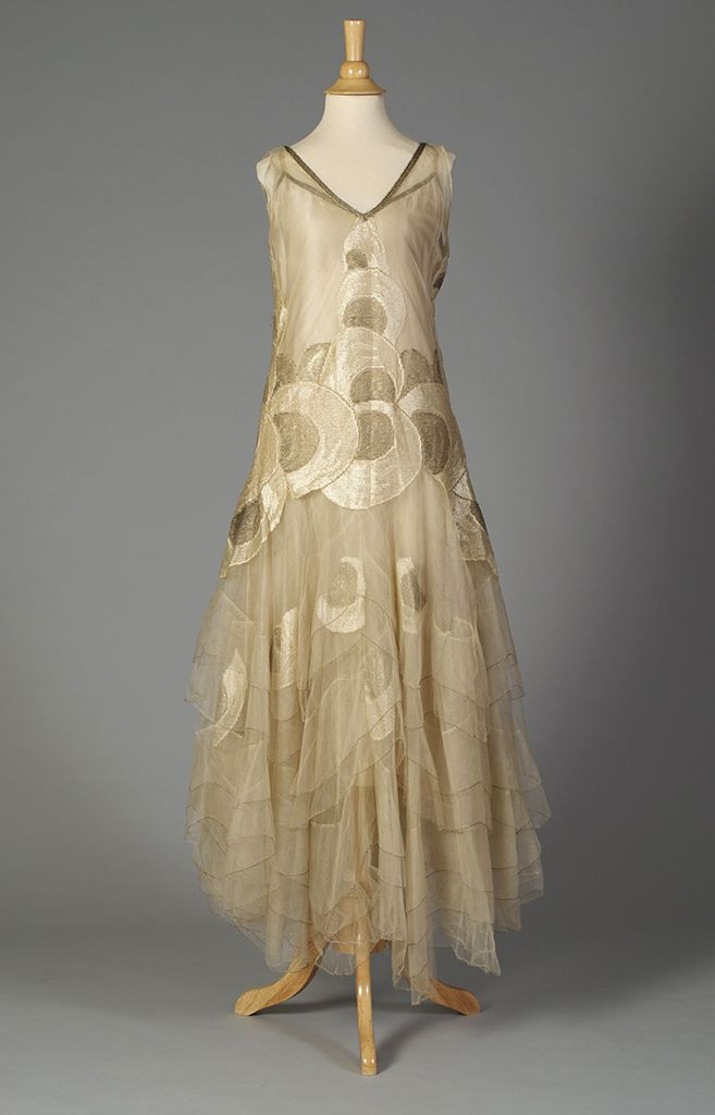Late 1920s, America - Evening dress of cream tulle with circular designs in silk and gold thread