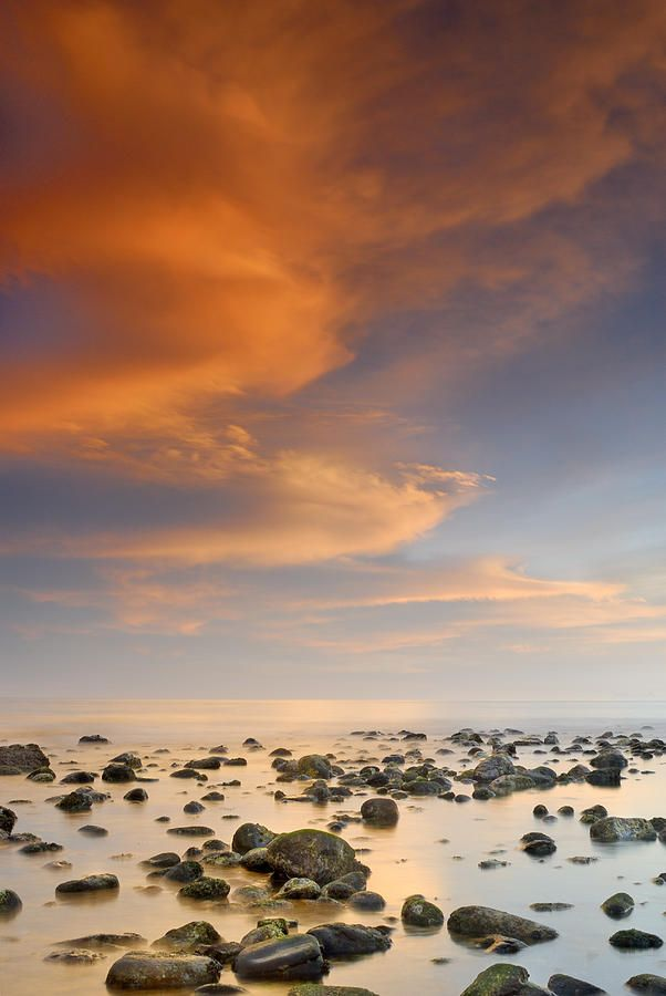 Orange sunset at the rocks - Mediterranean Sea - Marbella, Spain