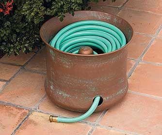 Great idea for a garden hose holder garden ideas for Garden hose idea