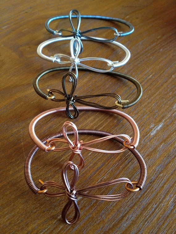 This beautifully handcrafted wire cross bracelet comes in child and adult sizes in various colors. on Etsy, $15.00