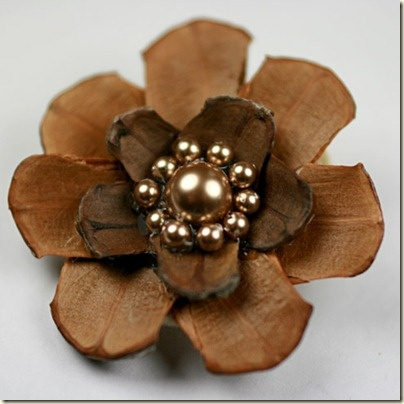 holy crap. Love this. Flower made of pinecone scales.    From http://fabricbowsandmore.blogspot.com/2011/01/my-take-on-pine-cone-flower.html