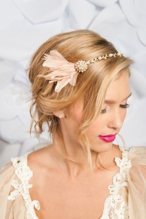 Headband with blush colored feathers..
