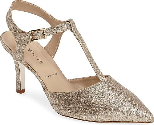 Ron White Women's Shoes in Champagne Glitter Suede Color. Add shimmer and shine to your formal attire with a sparkling, pointy-toe T-strap pump lifted by a slim stiletto heel. All Day Heels technology featuring PORON cushioning ensures lasting comfort.
