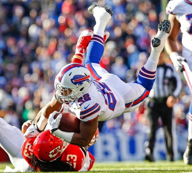 Buffalo Bills running back Fred Jackson (22) is upended by Kansas City Chiefs free safety Kendrick Lewis (23) after a 10-yard run during the third quarter. (Bill Wippert/AP)
