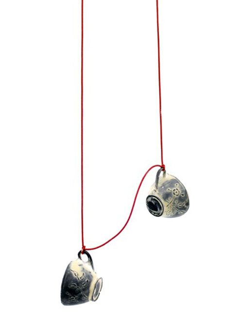 Henriette Schuster Pendant: Teacups, 2013 Blackened silver, elastic: