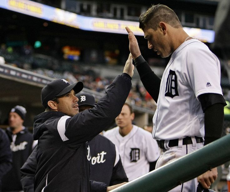 Detroit Tigers second baseman Ian Kinsler (3) high-fives manager Brad Ausmus after scoring a run to tie the game 1-1 in the first inning of their AL Central game against the Cleveland Indians at Comerica Park in Detroit, on Tuesday, May 2, 2017. (Mike Mulholland | MLive.com)