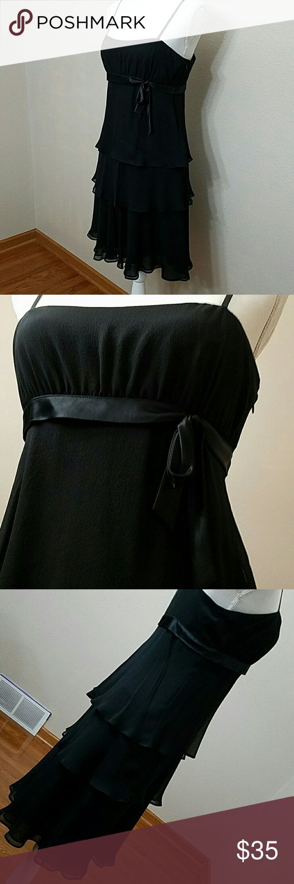 "EUC Silk Nine West Perfect Little Black Dress 6 Three layers of silky, crepe like material cascade down. A satiny trim all the way around the dress accenting the breastline, tied in a bow as if you were a present! You will be in this dress! Spaghetti straps, Fully lined with acetate, another layer of that of silky slip and then the outer dress. 100% Silk. 36"" overall length top of shoulders to bottom of dress. Waist 18"" across, breastline 15.5"" across. (Measurements taken from inside for…"