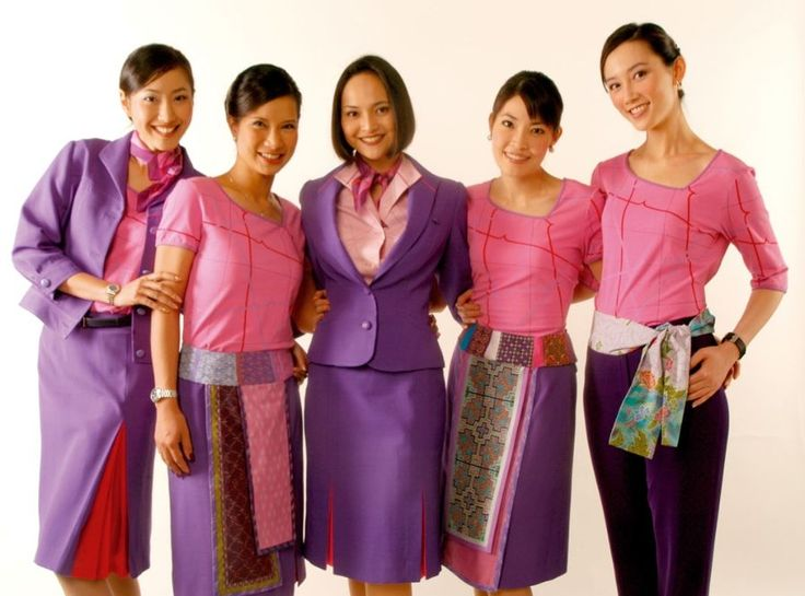 The current colourful uniform styles being worn by THAI's staff.  The  colours reflect the carrier's latest corporate branding, launched in April 2005.  (THAI) https://en.wikipedia.org/wiki/Thai_Airways