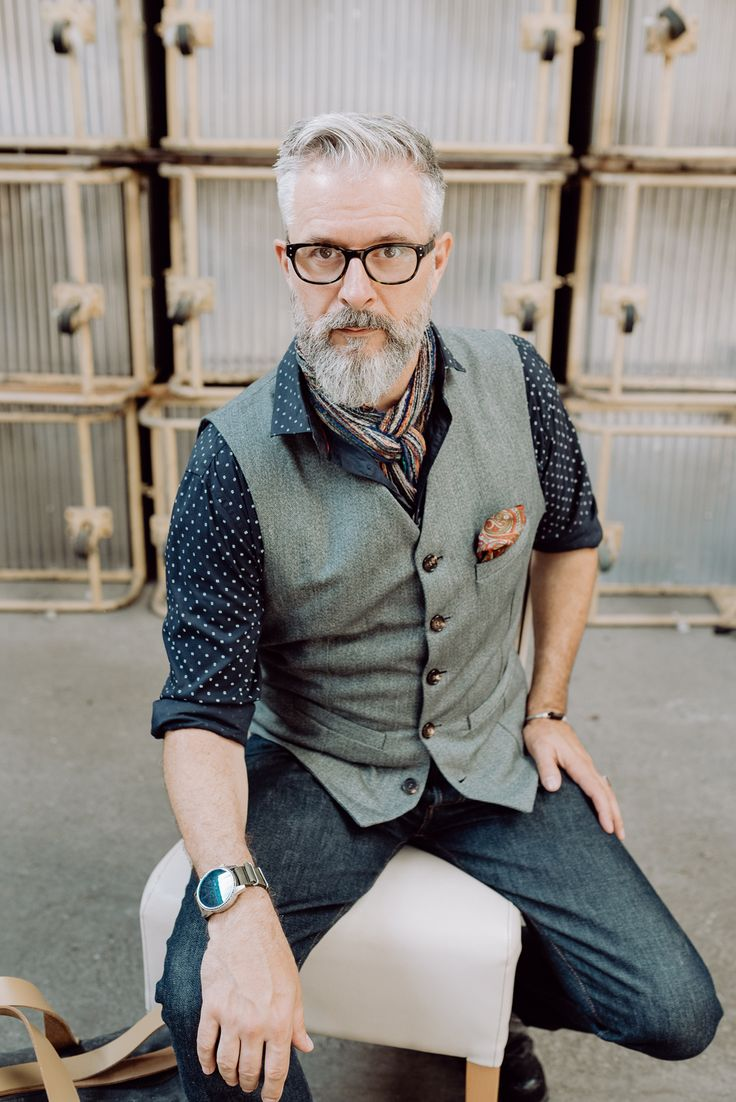 Bruno Streich, the designer of the STREICH bags and clothes wears a waistcoat out of 1970ies swiss army tenu blau fabric. #streichbag #brunostreich #waistcoat #beard #beardmodel #saltandpepper #glasses