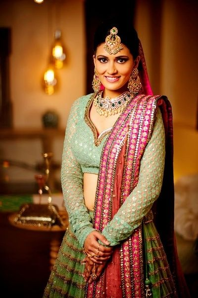 Engagement Lehengas - Bride in a Mint Green Lehenga with Golden Sequinned Embroidery and a Pink Net Dupatta | WedMeGood #wedmegood #indianbride #indianwedding #Bridal #lehenga #mintgreen #pink #gold #engagementlehenga
