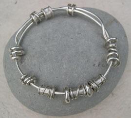 Silver expanding bead bangle