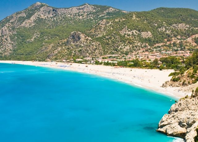 Olu Deniz, #Turkey    Olu Deniz, also known as Blue Lagoon, is probably one of the most photographed #beaches in #Europe, with the beautiful green peninsula jetting out into the bright blue sea.