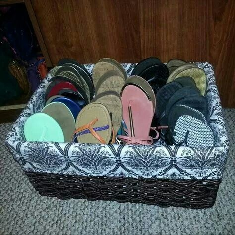 Sandles and flip flops in a basket to save room and organize.