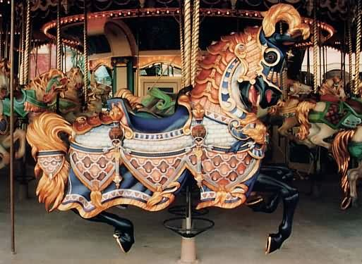 The lead horse is usually the horse most decorated and in front of the chariot.: Carousels Animal,  Carrousel,  Merry-Go-Round, Carousels Horses,  Whirligig,  Roundabout, Euro Disney, Wooden Hors, Carousels Horsey