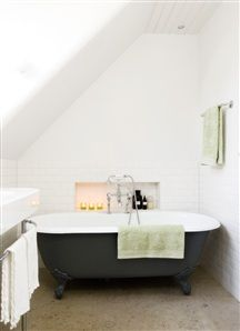 I love this bath. The look, the layout, and that super clever built in shelf by the tub.