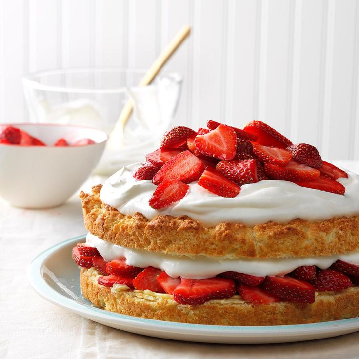 """Grandma's Strawberry Shortcake Recipe -""""I CAN still taste the sweet juicy berries piled over warm biscuits and topped with a huge dollop of fresh whipped cream. My father added ever more indulgence to this strawberry dessert by first buttering his biscuits."""""""