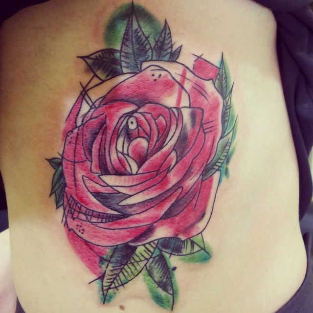Red rose tattoo on rib cage. Artist Victor at http://www.exotictattoopiercing.com/ https://www.facebook.com/Exotic-Tattoos-and-Piercings-418666600080/timeline/ For further inquires contact Victor at exotic@exotictattoopiercing.com