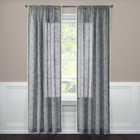 Horizontal stripes edged with pom pom trim create a fun look in the Pom Stripe Window Sheer curtain panel from Threshold. This drapery panel adds both privacy and personality to your home.