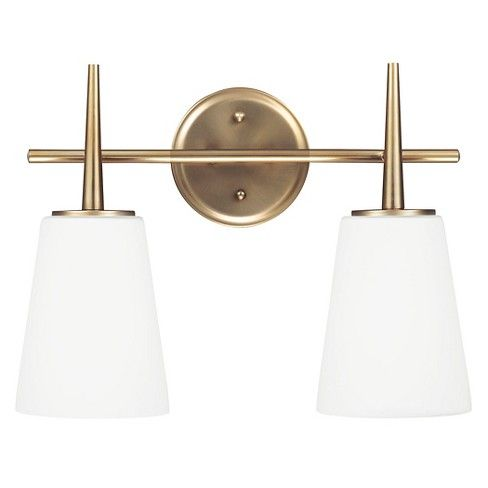 The Sea Gull Lighting Driscoll two light vanity fixture in satin bronze provides abundant light for your bath vanity, while adding a layer of today's style to your interior design. The 1960â™s-inspired Driscoll Collection features the clean lines of tapered stems and glass shades. Simplicity combined with sophistication creates this strikingly modern look.