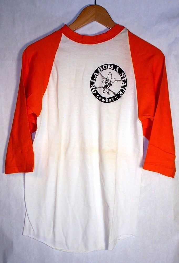 Great vintage condition, no stains or tears.  Super soft 70/30 cottonpoly blend material.<br/><br/>AWESOME 1970s Oklahoma State Cowboys baseball tee with Pistol Pete swinging a bat ! Perfect for any OSU game or event, you're not likely to see another one like it anywhere in Oklahoma or on campus!   eBay!