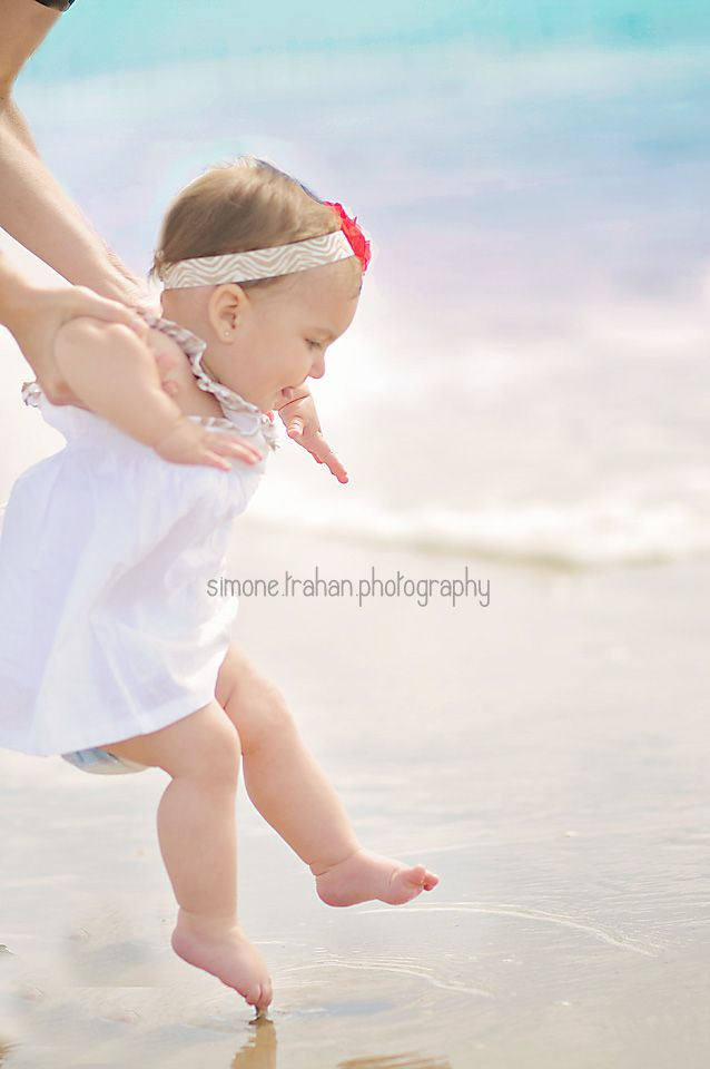 I like that the shot was taken at baby's level. A shot of baby experiencing the ocean.