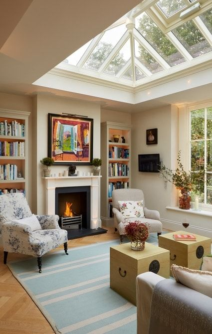 Lounge room within orangery featuring fireplace