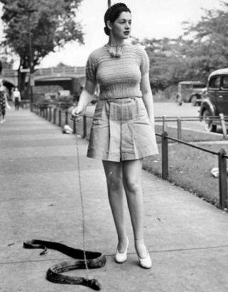 Burlesque queen Miss Zorita walking her snake - http://www.cultofweird.com/americana/miss-zorita-burlesque-snake/