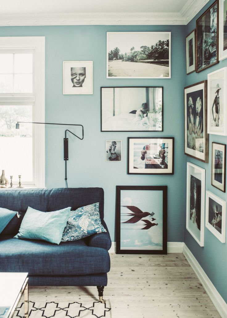 Forget those tall vases filled with dried sticks and branches collecting dust in the corners of your home and go for a much more stylish solution - a corner gallery wall grouping! The cool, blue hues in this art are a lovely addition to a very blue space, and the frame designs are all kept fairly simple so as to not compete with one another. Smart.