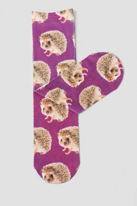 These adorable Hedgehogs Socks are a great way to start your day! The purple socks have an all over baby hedgehog print. Cute baby animals are always a surefire way to brighten up a day!<br /> <br /> - Imported