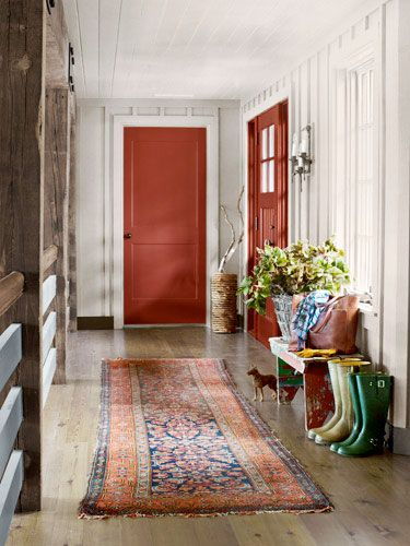 Rustic red doors (Ben. Moore's Red Rock) in entry.