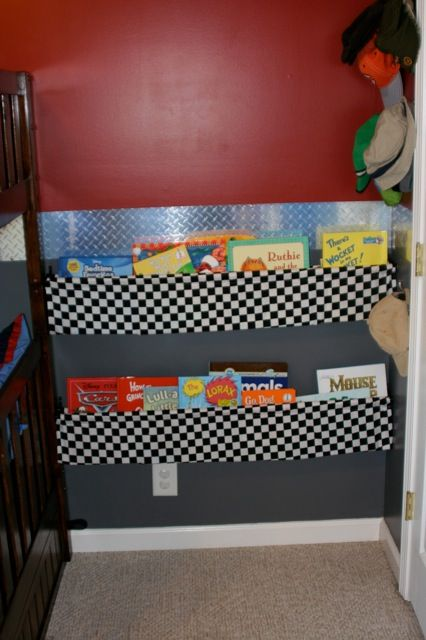 Bookshelves made out simple dowels, double rod drapery rods and fabric.