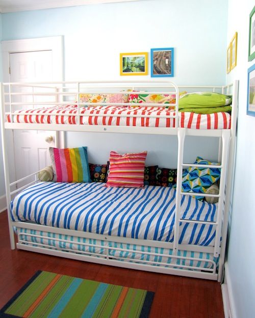 IKEA tromso bunk beds - small profile and with trundle for inevitable nights when a parent is needed....
